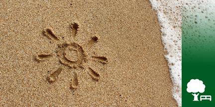 In Strand gemalte Sonne