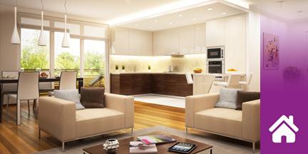 Blick in Wohnraum mit Couchgarnitur und Küchenzeile